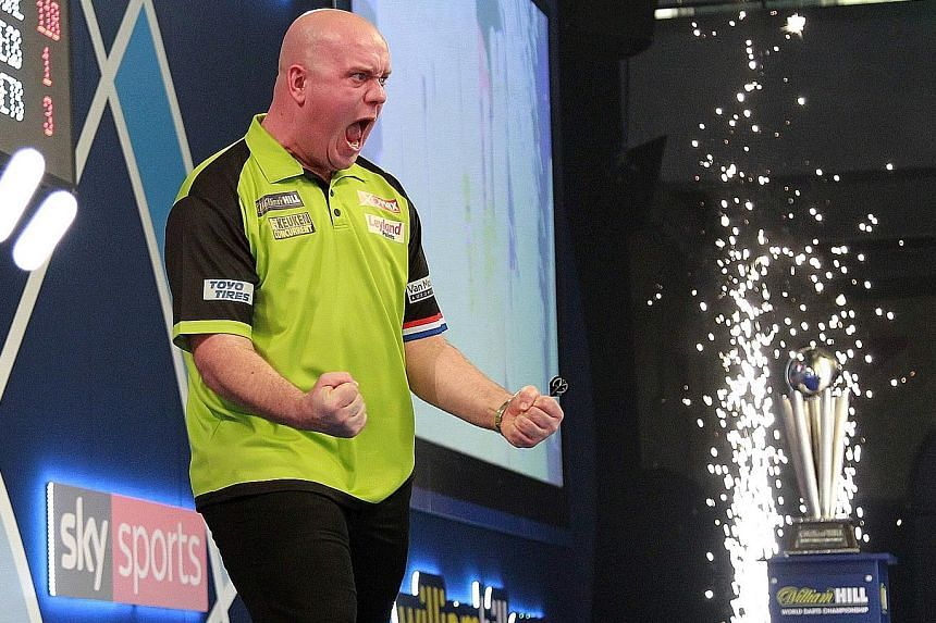 Above: Fans reacting during the PDC World Championship final between Briton Michael Smith and Dutchman Michael van Gerwen at the Alexandra Palace in north London, on Tuesday. Left: Van Gerwen celebrating as pyrotechnics ignite after he beat Smith 7-3