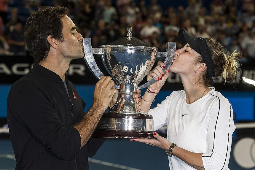 Switzerland's Roger Federer and his mixed doubles partner Belinda Bencic with the Hopman Cup, after defeating Germany's Alexander Zverev and Angelique Kerber in yesterday's final.