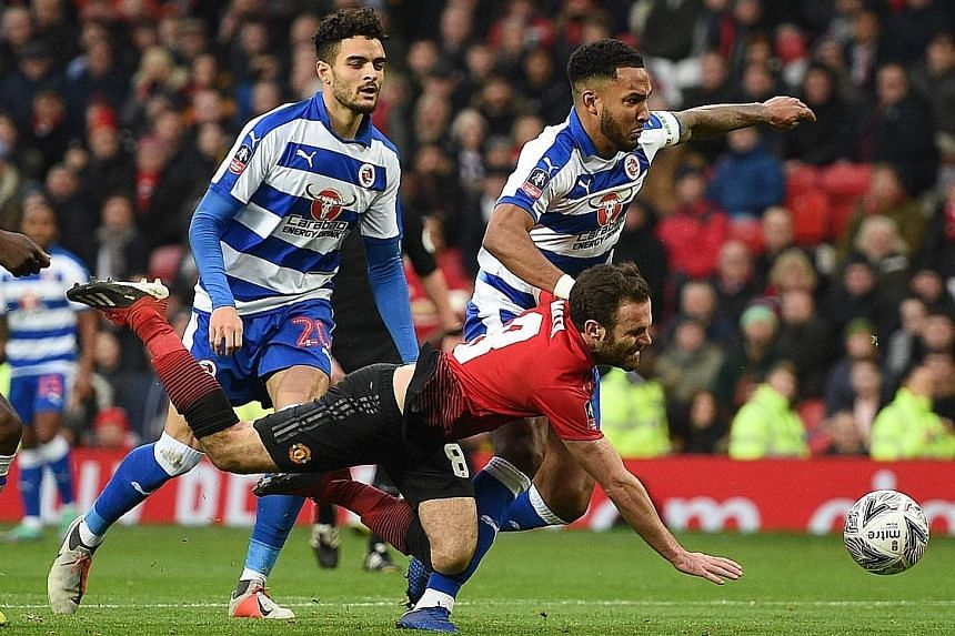 Juan Mata being fouled against Reading in the FA Cup third round at Old Trafford. He scored United's opener from the spot kick given by the video assistant referee.