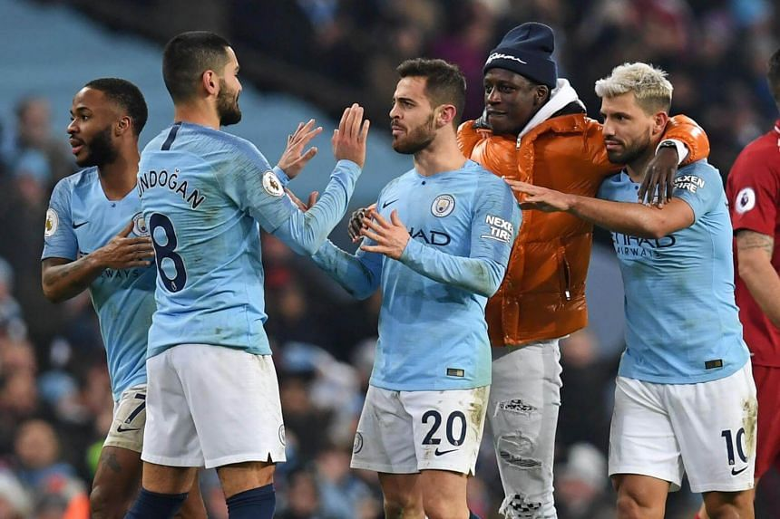 Manchester City players celebrate on the pitch after the match against Liverpool at the Etihad Stadium in Manchester, on Jan 3, 2019.