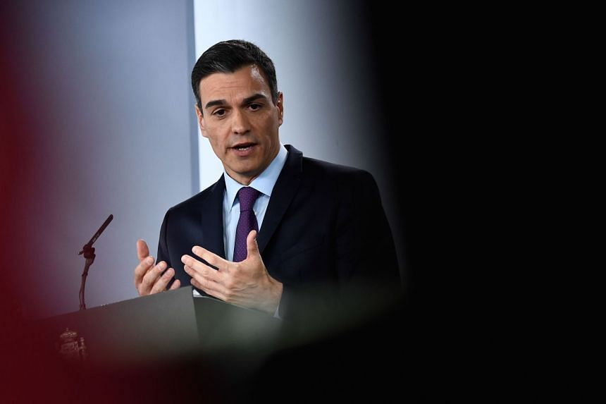 Spanish Prime Minister Pedro Sanchez gestures during a press conference.