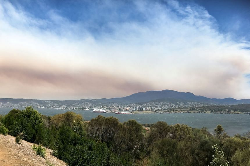 Smoke from a bushfire in south-west Tasmania hovering above the state capital Hobart last Friday.