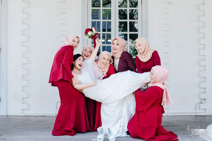 """Sarawakian Esther Joseph Kim celebrating her wedding with six Muslim friends in attendance as her bridesmaids. Photographer Ariffin Husain described it as """"the most unique wedding in 2018"""", and said he hoped to see more such multicultural ceremonies"""