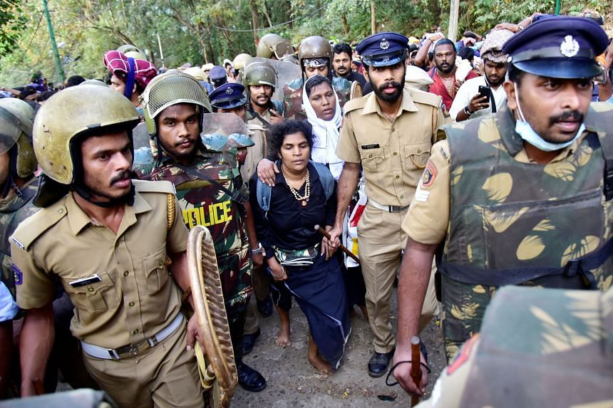 The two women who caused the furore - Ms Bindu Ammini, 42, and Ms Kanaka Durga, 44 - being escorted by police after they tried to enter the Sabarimala temple in December last year.