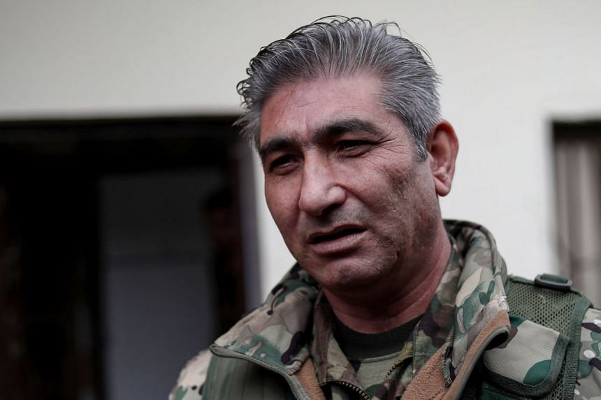 Redur Khalil speaking during an interview in the northeastern Syrian town of Amuda.