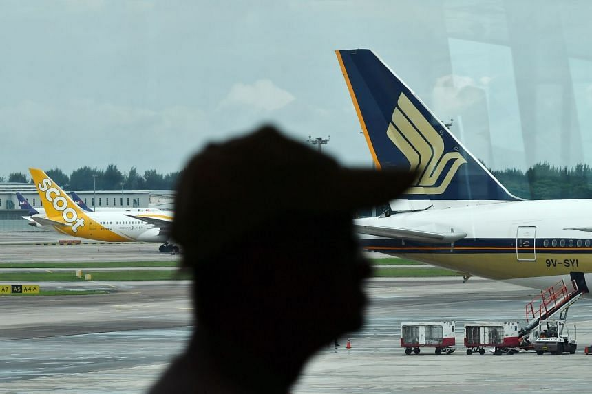 A Singapore Airlines plane (right)  at Changi Airport Terminal 2.