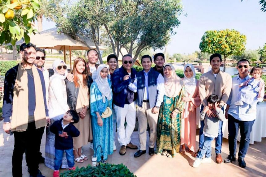 Datuk Seri Azmin Ali (centre right) and Datuk Seri Hishammuddin Hussein (centre left, with sunglasses), along with their families, holidaying in Morocco.
