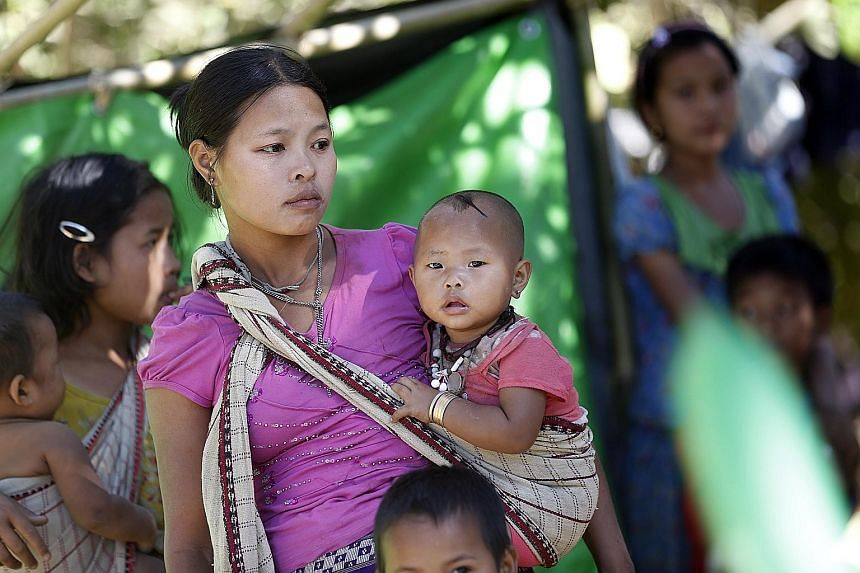 Ethnic Rakhine people, who fled from an area of conflict, at a temporary camp in Kyauk Taw township, in northern Rakhine state, yesterday.