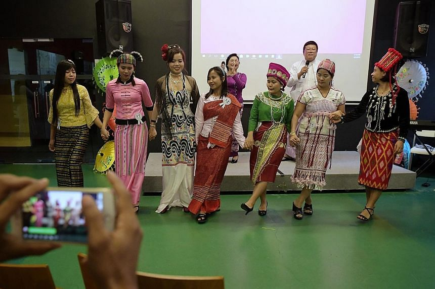 Myanmar domestic workers dressed in their ethnic costumes performing a dance as the Foreign Domestic Worker Association for Social Support and Training (Fast) celebrated Myanmar's 71st Independence Day, which fell on Friday. Yesterday's event was hel