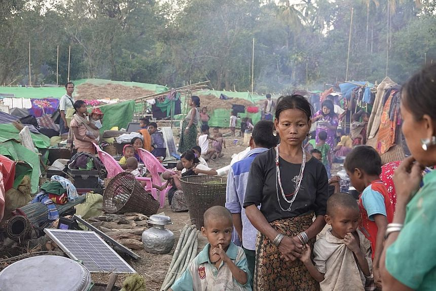 Ethnic Rakhine people, who fled from an area of conflict, at a temporary camp in Kyauk Taw township, northern Rakhine state, last Thursday. In recent months, the Arakan Army has ramped up attacks on the Myanmar military in Rakhine, from where some 70