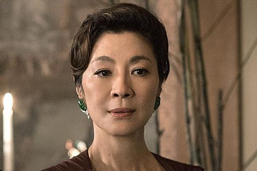 While the character of arrogant mother Eleanor Young is portrayed in the book as all-out mean, actress Michelle Yeoh (left) worked on making her film role (above) vulnerable and more human.