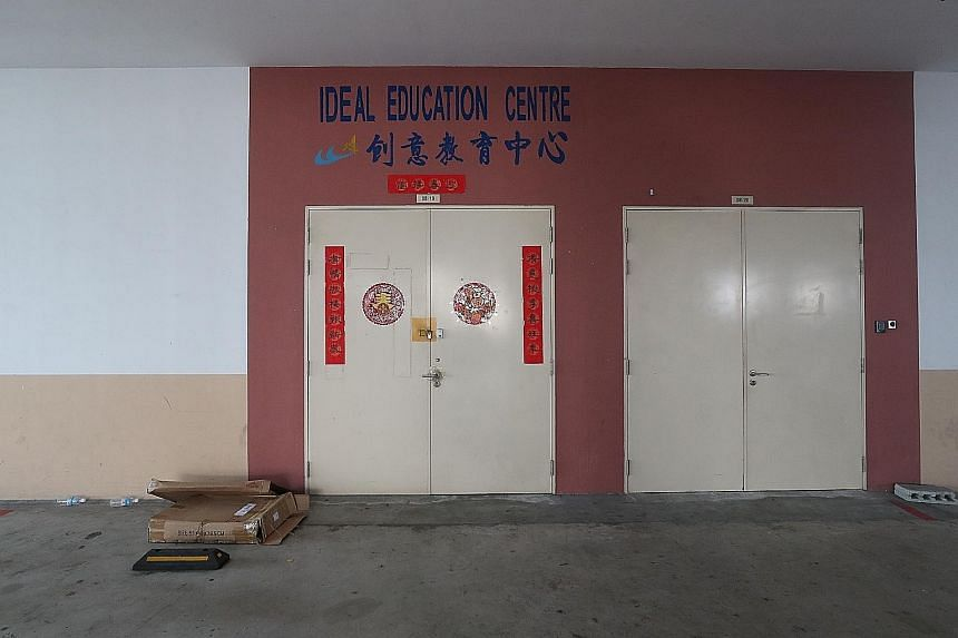 Above: The education centre where Soo Jia He was accidentally locked inside. He had been left alone for around 10 minutes, say his parents, who rushed back to their office to find their son lying at the foot of the building. Left: Prayers being perfo