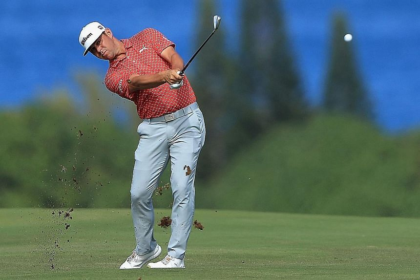Gary Woodland nailed a spectacular eagle on the 15th hole and added a birdie on 18th at the Kapalua Plantation Course to restore a three-shot lead over Rory McIlroy at the Tournament of Champions in Hawaii on Saturday.