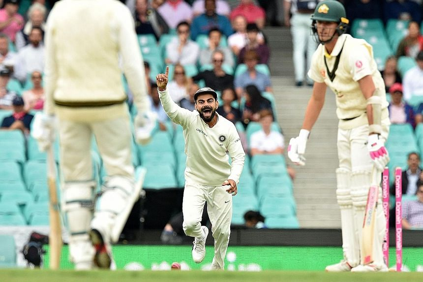 India captain Virat Kohli celebrating after Australia batsman Pat Cummins was clean bowled by Mohammed Shami on the fourth day of the fourth and final cricket Test between Australia and India at the Sydney Cricket Ground.