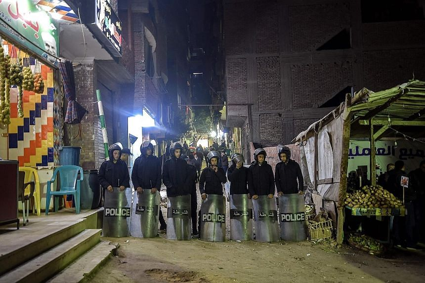 Police officers guarding the street leading to the church in Cairo where the bomb was found last Saturday.
