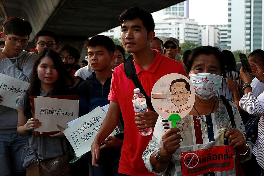 Activists protesting in Bangkok yesterday against a possible delay of an election set to be held on Feb 24, following the lifting of a ban on political activity imposed after a 2014 coup.