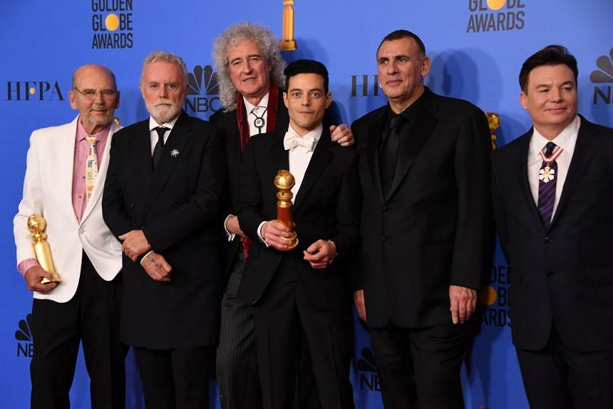 Best Actor in a Motion Picture – Drama for Bohemian Rhapsody winner Rami Malek poses with Graham King (second from right), Brian May (third from left) and Mike Myers (right) at the 76th annual Golden Globe Awards on Jan 6, 2019.