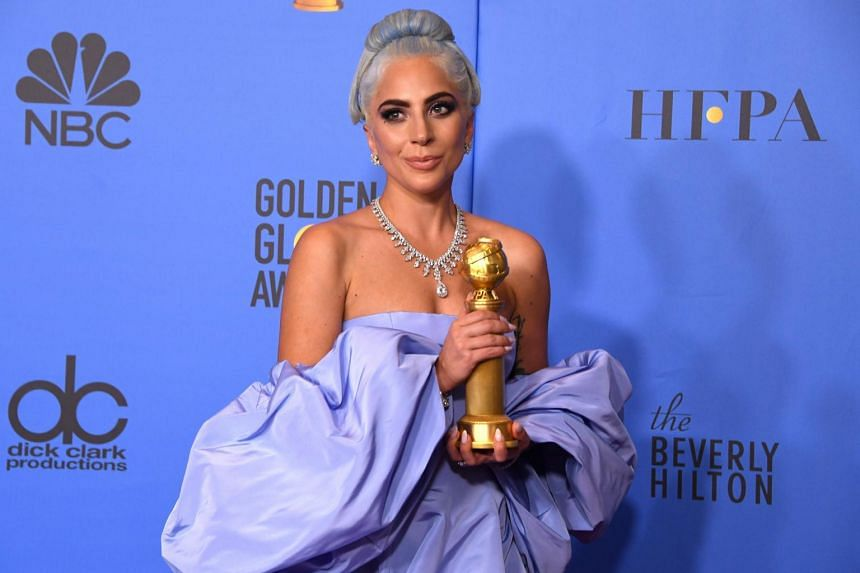 Lady Gaga poses with her trophy during the 76th annual Golden Globe Awards, on Jan 6, 2019.
