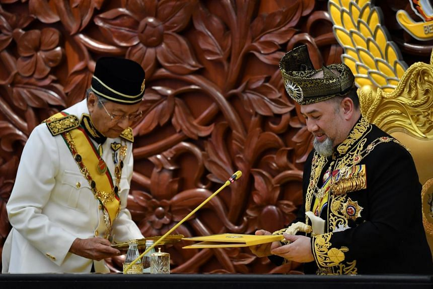Sultan Muhammad V (right) preparing to deliver an address in Kuala Lumpur as Malaysian Prime Minister Mahathir Mohamad looks on, on July 17, 2018.