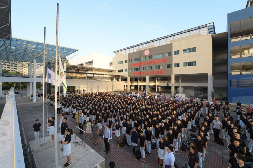 Students from Tampines Meridian Junior College during morning assembly on Jan 7, where the flags of Tampines JC and Meridian JC were lowered before the new TMJC flag was hoisted.