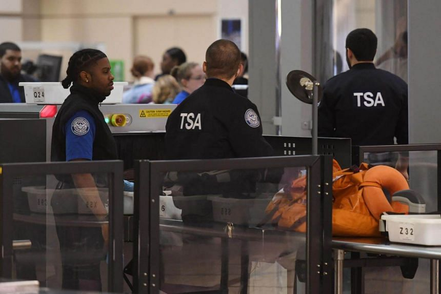 Transportation Security Administration officers screening passengers at the Los Angeles International Airport on Jan 5 2019