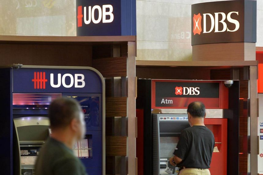 DBS and UOB have linked up with ride-hailing app partners that are evolving into fintechs - a cluster attracting premium valuations.