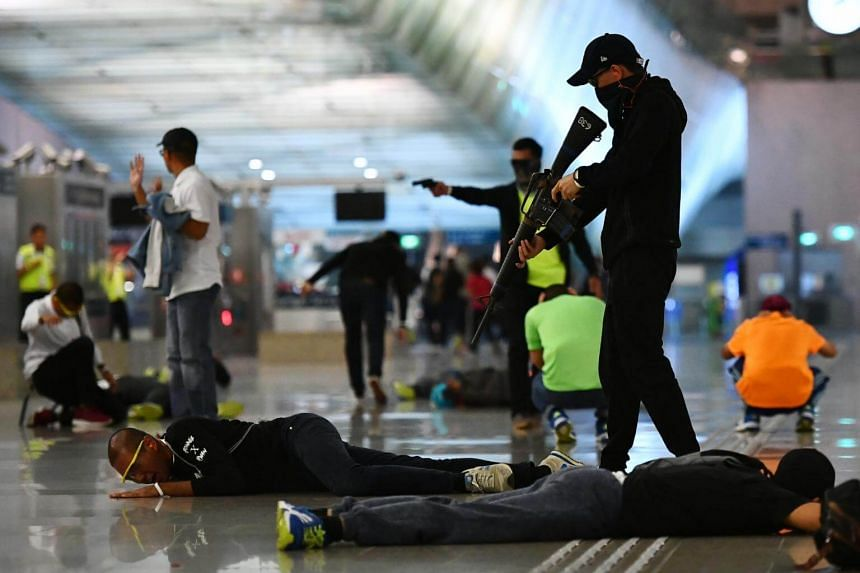 """File photo of """"gunmen"""" attacking commuters at Changi Airport MRT station during a counter-terrorism exercise """"Exercise Northstar"""", on Oct 17, 2017."""