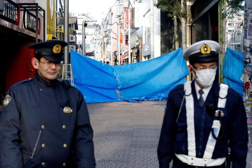 Policemen stand guard in front of a site where a car ploughed into crowds celebrating New Year's Day in a popular tourist area of Harajuku in Tokyo, Japan, on Jan 1, 2019.