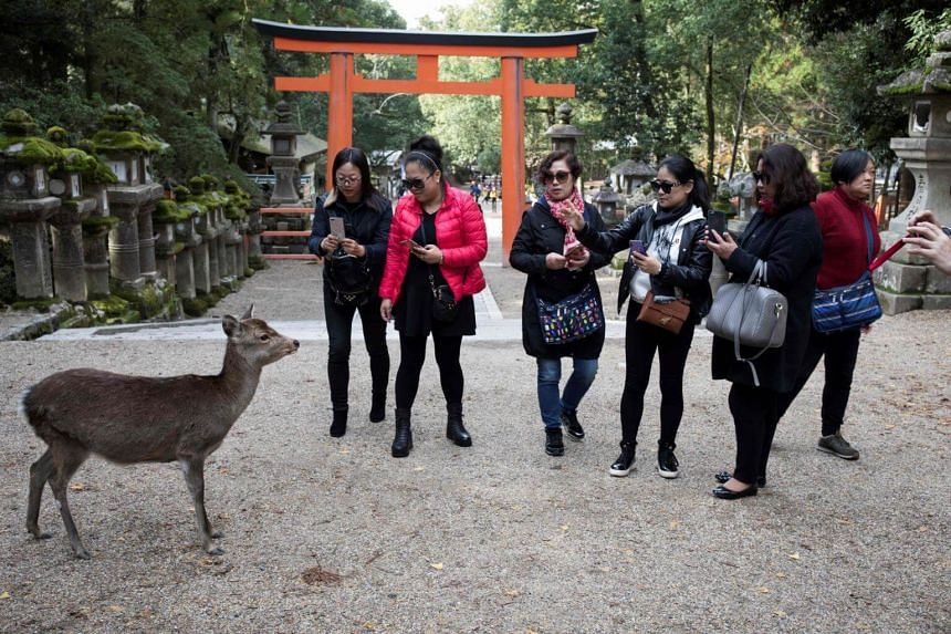 Tourists at Kasuga-Taisha Shrine in Nara park in Nara. Japan has been aggressively courting international tourists as a new pillar of economic growth.