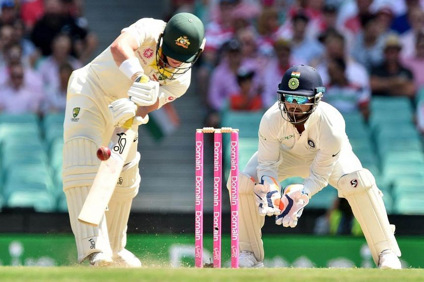Australia's batsman Marcus Harris (left) hits a ball as India's wicketkeeper Rishabh Pant looks on during the third day of the fourth cricket Test at the Sydney Cricket Ground, on Jan 5, 2019.