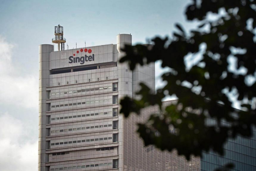 The Singtel logo seen on top of one of its buildings in Singapore.