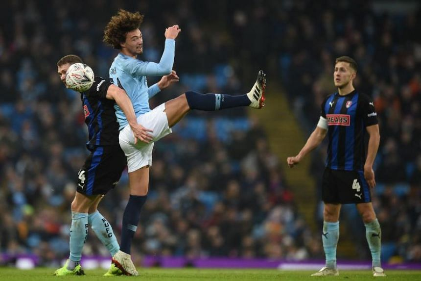 Rotherham's English striker Michael Smith (left) vies with Manchester City's Dutch defender Philippe Sandler (second from left) during the English FA Cup third round match at the Etihad Stadium in Manchester, north west England, on Jan 6, 2019.