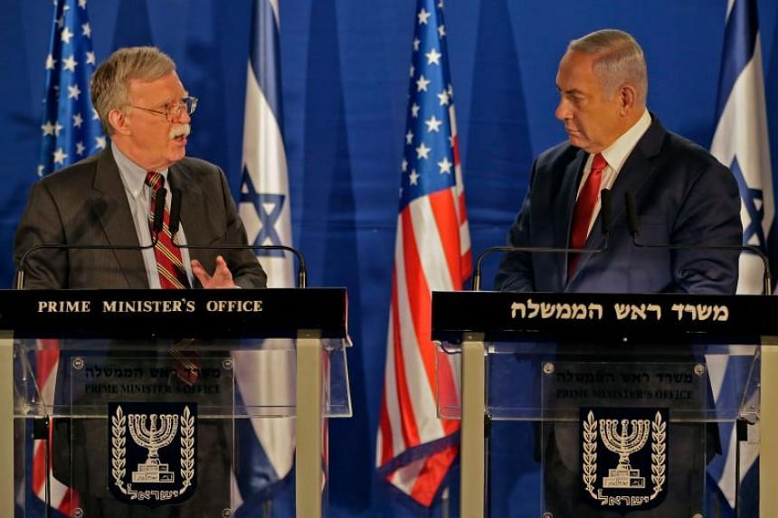 Israeli Prime Minister Benjamin Netanyahu (right) speaks with the US National Security Advisor John Bolton, during a statement to the media follow their meeting in Jerusalem on Jan 6, 2019.