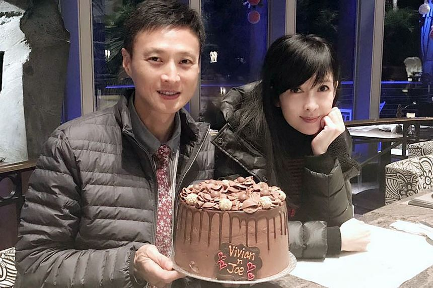 Hong Kong singer-actress Vivian Chow posted a photograph of herself with husband Joe Nieh, who was holding a cake, yesterday.