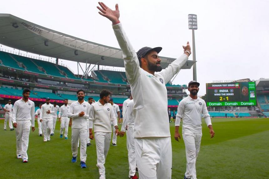India's captain Virat Kohli (centre) walks with teammates as they celebrate winning the Test series between India and Australia at the Sydney Cricket Ground on Jan 7, 2019.