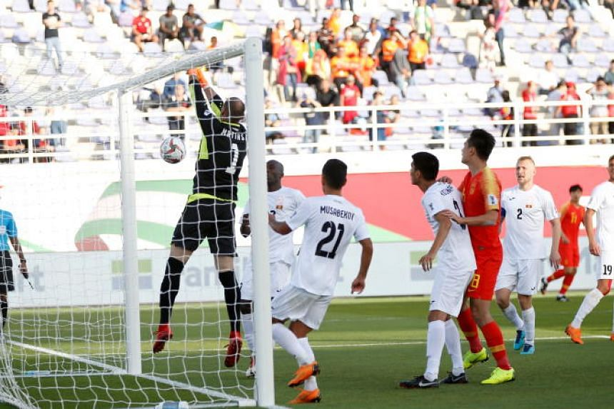 Matiash Pavel, goalkeeper of Kyrgyz Republic concedes a goal during the 2019 AFC Asian Cup group C preliminary round match between China and Kyrgyz Republic in Al Ain, United Arab Emirates, on Jan 7, 2019.