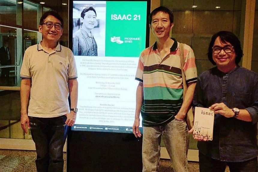 Poet Yong Shu Hoong (left) with publisher Enoch Ng (centre) and designer Little Ong (right) at the event, Isaac 21, where he donated two limited edition books to the library.