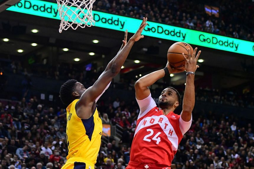 Toronto Raptors forward Norman Powell (right) drives to the basket as Indiana Pacers guard Victor Oladipo tries to defend during the fourth quarter at Scotiabank Arena, in Toronto, Canada, on Jan 6, 2019.