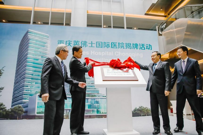 (From left) Raffles Medical Group's executive chairman Loo Choon Yong, Minister for Trade and Industry Chan Chun Sing, Mayor of Chongqing Municipality Tang Liangzhi and director of the management committee of Liangjiang New Area Duan Chenggang at ope