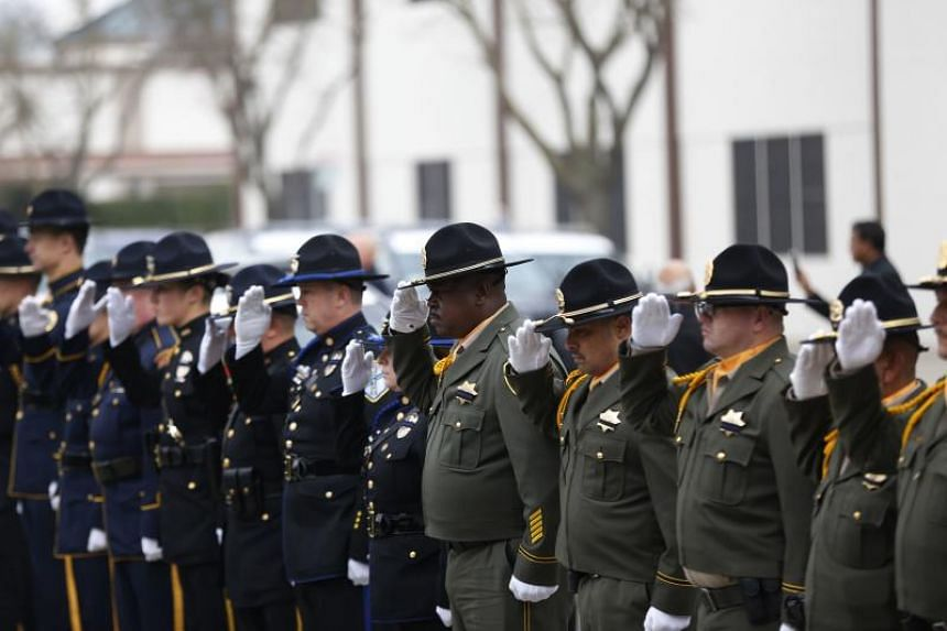 Police officers salute family members of slain Newman police officer Corporal Ronil Singh before a funeral service at CrossPoint Community Church on Jan 5, 2019.