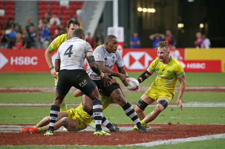 Australia and Fiji players in action during the HSBC Singapore Rugby Sevens final at the National Stadium on April 29, 2018.