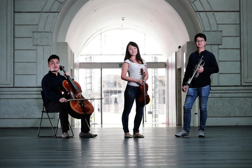 (From left) Cellist Wang Zihao, violinist Chikako Sasaki and trumpeter Lau Wen Rong will be performing as part of the Singapore Symphony Orchestra at its 40th anniversary gala concert at the Esplanade Concert Hall. on Jan 18, 2019.