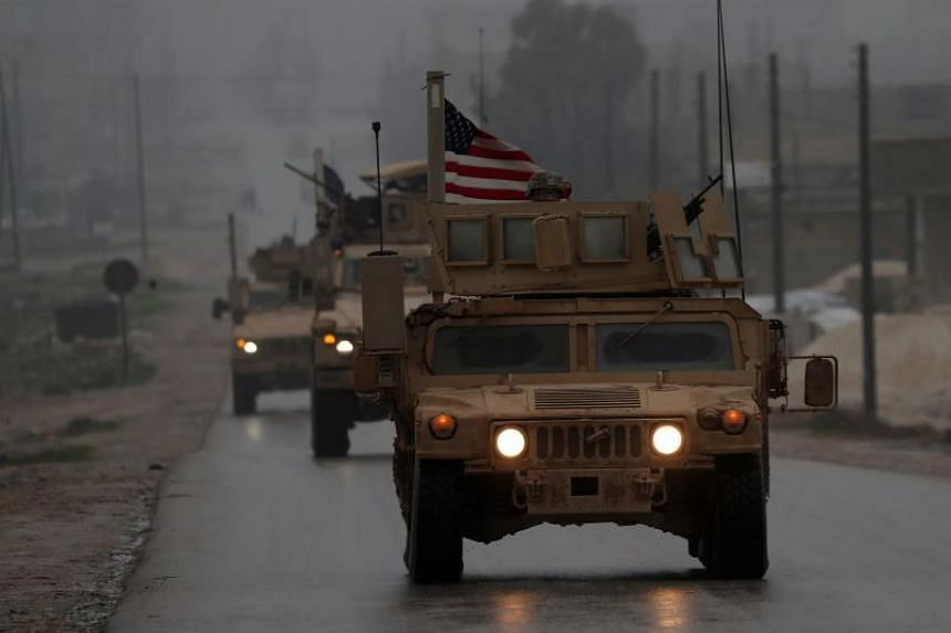 US military vehicles in Syria's northern city of Manbij.