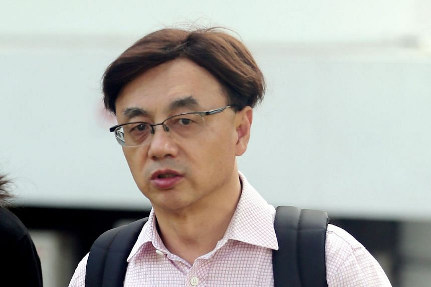 Nanyang Technological University associate professor Wang Jianliang is accused of driving in a rash manner by intentionally applying the emergency brake twice, causing another motorist to hit the rear of his vehicle.
