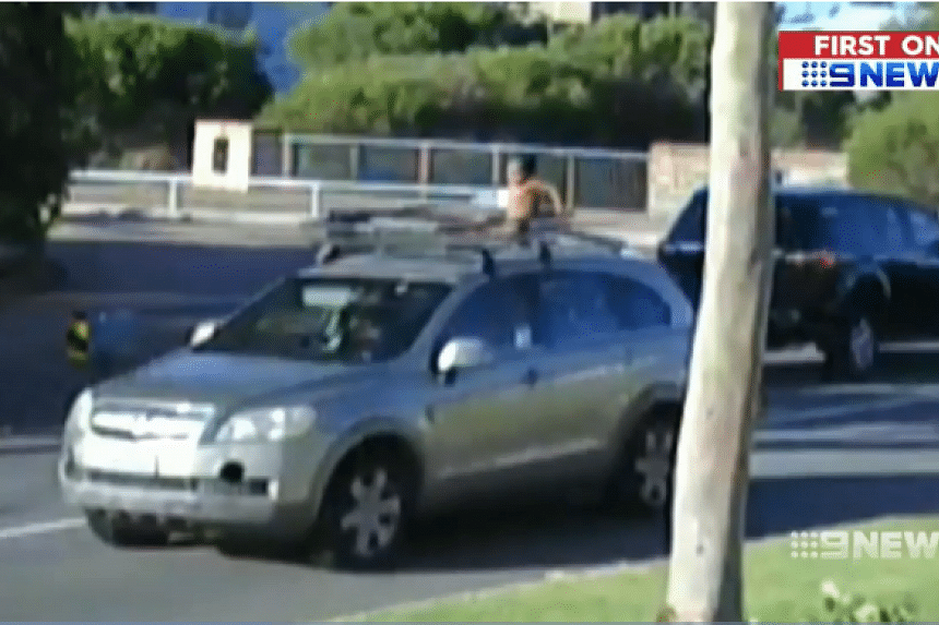 A four-year-old boy was filmed taking a joyride on the roof of his mother's car in Perth on Jan 4. PHOTO: SCREENGRAB FROM 9NEWS