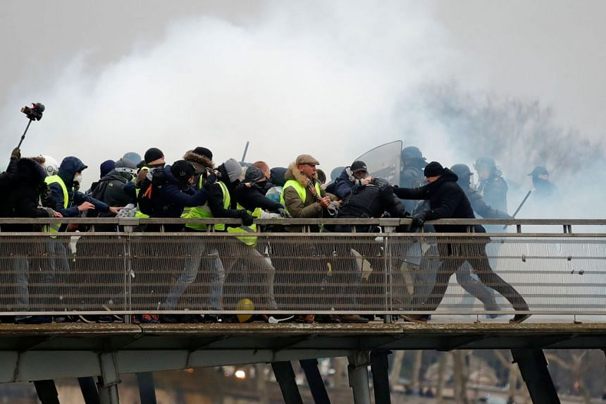 Dettinger (right) is seen during clashes with French Gendarmes on the Leopold-Sedar-Senghor bridge in Paris.