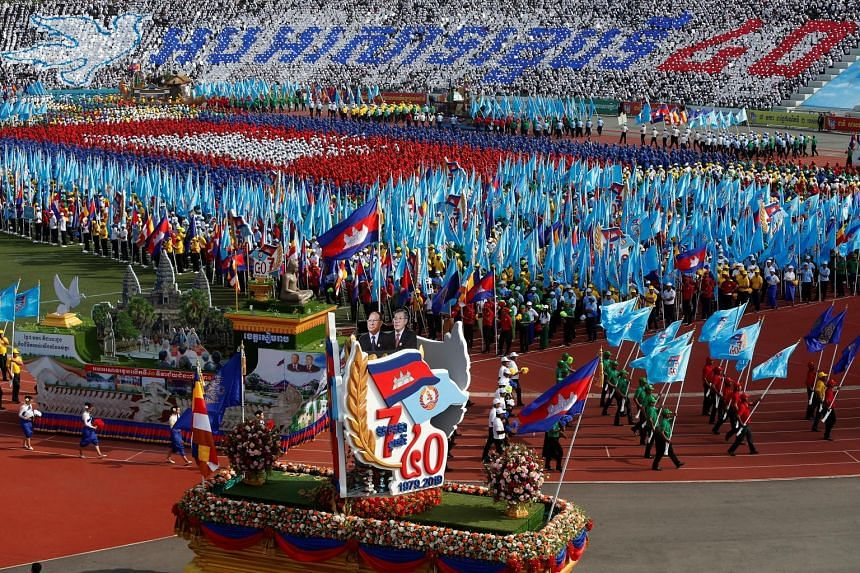 """Prime Minister Hun Sen arriving at the event yesterday. The 66-year-old, who has been in power for 33 years, hailed the day as Cambodia's """"second birthday"""". The ceremony marking the 40th anniversary of the expulsion of the Khmer Rouge regime, which r"""