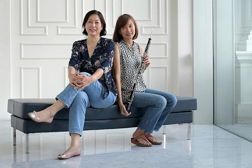 Sisters Karen (left) and Elaine Yeo have been playing together in the Singapore Symphony Orchestra since 1992.