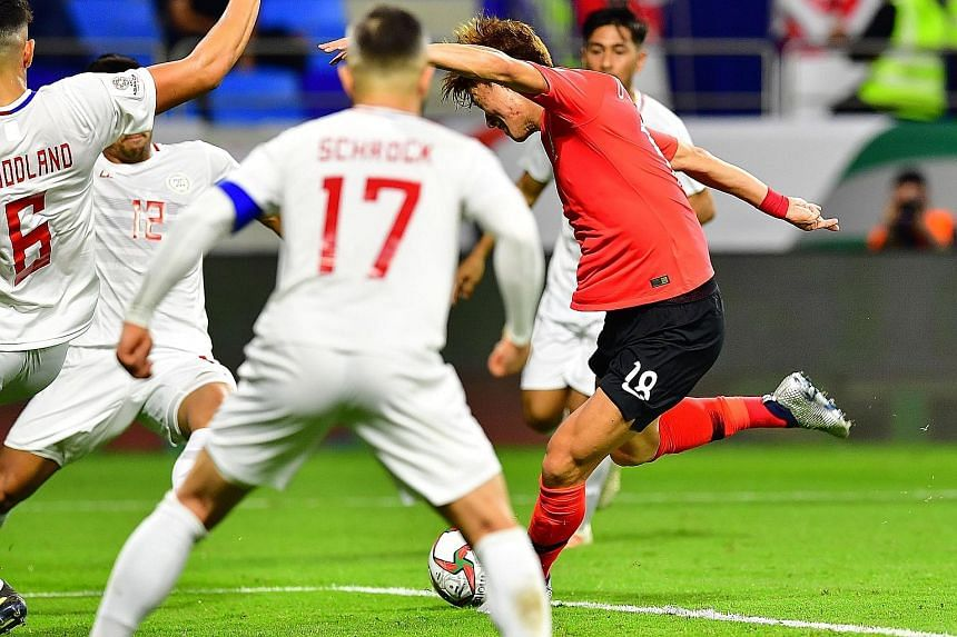 China's Yu Dabao rounding Kyrgyzstan goalkeeper Pavel Matiash in the 78th minute to score the winning goal in the 2-1 Asian Cup Group C victory yesterday. Below: South Korea forward Hwang Ui-jo made light of Tottenham Hotspur star Son Heung-min's abs