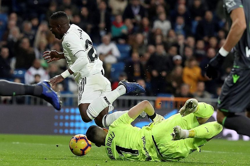 Real Sociedad custodian Geronimo Rulli colliding with Real Madrid forward Vinicius Jr on Sunday. The referee neither awarded a penalty nor consulted the VAR, to Real's dismay.